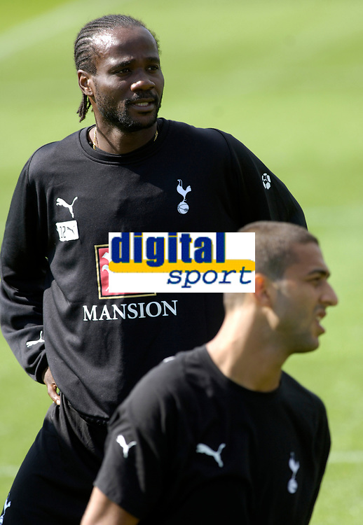 Photo: Daniel Hambury.<br />Tottenham Hotspur training session. 07/09/2006.<br />New Spurs signings Pascal Chimbonda (L) and Mido.