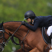 Adrienne Sternlicht riding Quidam MB in action during the $100,000 Empire State Grand Prix presented by the Kincade Group during the Old Salem Farm Spring Horse Show, North Salem, New York,  USA. 17th May 2015. Photo Tim Clayton