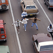 """Undocumented immigrants enter California by running into traffic on I-5 to avoid Border Patrol. The result of Operation Gatekeeper is that smugglers and their human cargo are forced to find much more dangerous routes for entry into the United States. Many head east into the mountains while others take the """"Bonzai Run"""" head on into I-5 traffic through the Port of Entry. Please contact Todd Bigelow directly with your licensing requests. PLEASE CONTACT TODD BIGELOW DIRECTLY WITH YOUR LICENSING REQUEST. THANK YOU!"""