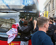 England supporters stop by a bus and continue to chant for their team as they march towards Trafalgar Square. 03/07/2021. Marcin Riehs/Pathos