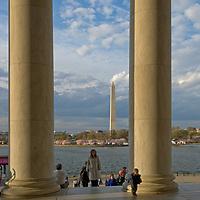 Tourists wander between huge columns at the Jefferson Memorial in Washington, D.C.