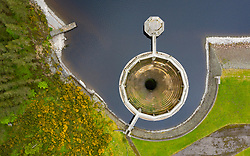 Aerial view of glory hole spillway at Whiteadder Reservoir and dam , Scotland, UK