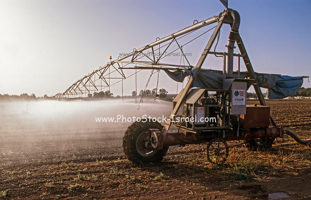 Irrigation robot watering a field. Photographed in the negev Desert, Israel