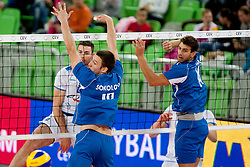 Alen Pajenk #2 of Slovenia and Genadi Sokolov #18 of Israel during qualifications match for FIVB Men's World Championship 2014 between National team Slovenia and Israel in pool B on May 24, 2013 in SRC Stozice, Ljubljana, Slovenia. (Photo By Urban Urbanc / Sportida)