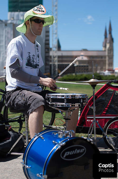 A man drums on Parliament Hill during a protest against Monsanto. May 31, 2014.