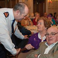 Superintendant Derek Smart chatting with John and Margaret Staunton from Ennis at the Ennis Garda Christmas Party for the Elderly
