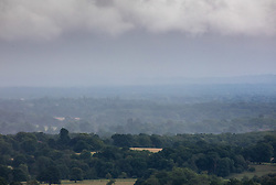 © Licensed to London News Pictures. 08/07/2020. Surrey, UK. Mist gathers over Dorking in the Surrey Hills as the midsummer rain continues to fall as weather forecasters predict a mild but wet couple of days ahead followed by sunnier and warmer weather for the weekend. Photo credit: Alex Lentati/LNP