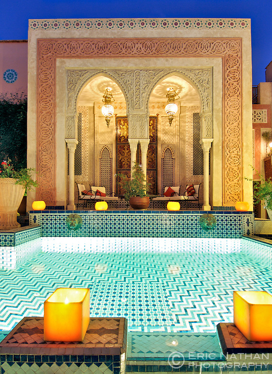 Dusk view of the pool and relaxation area in the Palais Sebban riad in Marrakech, Morocco.
