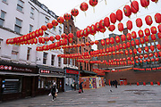 Red lanterns ready for Chinese New Year at Chinatown as the national coronavirus lockdown three continues on 3rd March 2021 in London, United Kingdom. With the roadmap for coming out of the lockdown has been laid out, this nationwide lockdown continues to advise all citizens to follow the message to stay at home, protect the NHS and save lives, and the streets of the capital are quiet and empty of normal numbers of people.