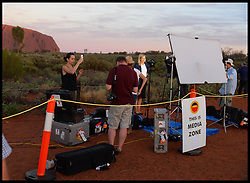General Views of The Television media filming at  Ayers Rock/Uluru, Australia. Monday, 21st April 2014. Uluru, also known as Ayers Rock and officially gazetted as Uluru / Ayers Rock, is a large sandstone rock formation in the southern part of the Northern Territory in central Australia. Picture by Andrew Parsons / i-Images
