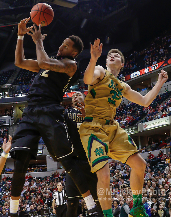 INDIANAPOLIS, IN - DECEMBER  20: Vince Edwards #12 of the Purdue Boilermakers battles for a rebound with Steve Vasturia #32 of the Notre Dame Fighting Irish at Bankers Life Fieldhouse on December 20, 2014 in Indianapolis, Indiana. Indiana defeated Butler 82-73. (Photo by Michael Hickey/Getty Images) *** Local Caption *** Vince Edwards; Steve Vasturia