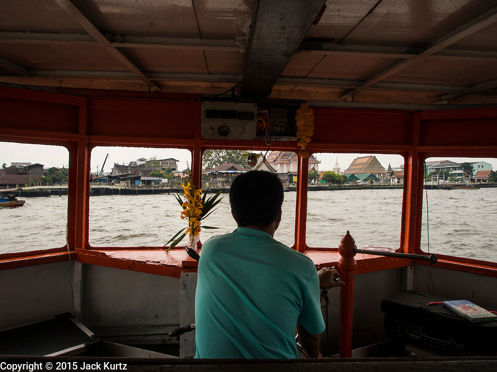 11 FEBRUARY 2015 - BANGKOK, THAILAND: A cross river ferry approaches the pier at Wat Kalayanamitr, a large Buddhist temple next to the Santa Cruz neighbhorhood in the Thonburi section of Bangkok. There has been a Catholic church on the site since 1770. The current church was finished in 1916. It is one of the oldest Catholic churches in Thailand. Now the neighborhood around the church is known for the Thai adaptation of Portuguese cakes baked in the neighborhood. Several hundred Siamese (Thai) Buddhists converted to Catholicism in the 1770s. Some of the families started baking the cakes. When the Siamese Empire in Ayutthaya was sacked by the Burmese, the Portuguese and Thai Catholics fled to Thonburi, in what is now Bangkok. The Portuguese established a Catholic church near the new Siamese capital. There are still a large number of Thai Catholics living in the neighborhood around the church.     PHOTO BY JACK KURTZ