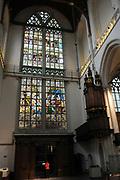 De Nieuwe Kerk is een kerkgebouw in Amsterdam. De kerk is gelegen aan de Dam, naast het Paleis op de Dam.De Nieuwe Kerk wordt, sinds soeverein-vorst Willem in 1814 in deze kerk de eed op de grondwet aflegde, ook gebruikt voor de inzegening van koninklijke huwelijken en voor inhuldigingen. De inhuldiging van Koningin Beatrix vond er plaats op 30 april 1980. Op dezelfde datum in 2013 zal de inhuldiging van haar zoon en opvolger Willem-Alexander ook daar plaatsvinden.<br /> <br /> The New Church is a church building in Amsterdam. The church is located on Dam Square, next to the Palace on the Dam.De New Church in this church in 1814, since sovereign-prince Willem laid aside the oath to the Constitution, also used for the blessing of royal weddings and inaugurations. The inauguration of Queen Beatrix took place on April 30, 1980. On the same date in 2013, the inauguration of her son and heir Willem-Alexander will also take place there.<br /> <br /> Op de foto / On the photo:   hoofdingang waardoor toekomstig Koning Willem Alexander en Koningin Maxima door binnen komen<br /> <br />  main entrance which future King Willem Alexander and Queen Maxima will enter