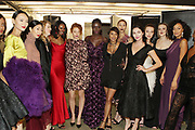 """NEW YORK, NEW YORK-FEBRUARY 13: Designer Aisha McShaw with her models backstage during the """"CAPTURED"""" the 2019 Fall/Winter Collection presented by Designer Aisha McShaw during New York Fashion Week and held at the Gallery at Prince George Ballroom on February 11, 2019 in New York City.  (Photo by Terrence Jennings/terrencejennings.com)"""