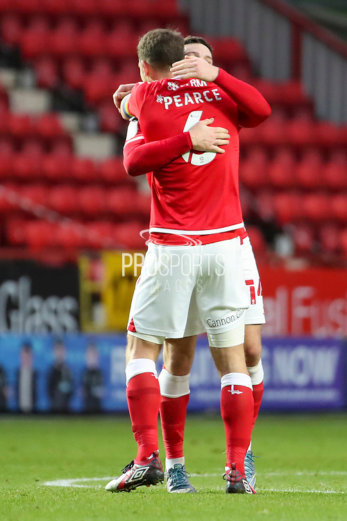 Charlton Athletic attacker Conor Washington (14) celebrates goal with Charlton Athletic defender Jason Pearce (6) during the EFL Sky Bet League 1 match between Charlton Athletic and AFC Wimbledon at The Valley, London, England on 12 December 2020.