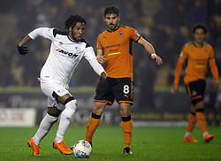 Derby County's Kasey Palmer (left) and Wolverhampton Wanderers' Ruben Neves battle for the ball