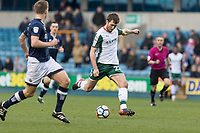 Football - 2017 / 2018 FA Cup - Third Round: Millwall vs. Barnsley<br /> <br /> Jason McCarthy (Barnsley FC) strikes the ball from distance towards the Millwall goal at The Den.<br /> <br /> COLORSPORT/DANIEL BEARHAM