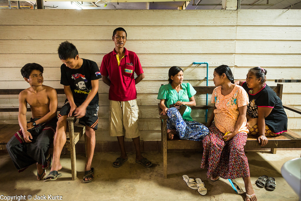 20 MAY 2013 - MAE KASA, TAK, THAILAND:  Burmese people wait for word on their loved ones in the SMRU clinic in Mae Kasa, Thailand. Health professionals are seeing increasing evidence of malaria resistant to artemisinin coming out of the jungles of Southeast Asia. Artemisinin has been the first choice for battling malaria in Southeast Asia for 20 years. In recent years though,  health care workers in Cambodia and Myanmar (Burma) are seeing signs that the malaria parasite is becoming resistant to artemisinin. Scientists who study malaria are concerned that history could repeat itself because chloroquine, an effective malaria treatment until the 1990s, first lost its effectiveness in Cambodia and Burma before spreading to Africa, which led to a spike in deaths there. Doctors at the Shaklo Malaria Research Unit (SMRU), which studies malaria along the Thai Burma border, are worried that artemisinin resistance is growing at a rapid pace. Dr. Aung Pyae Phyo, a Burmese physician at a SMRU clinic just a few meters from the Burmese border, said that in 2009, 90 percent of patients were cured with artemisinin, but in 2010, it dropped to about 70 percent and is now between 55 and 60 percent. He said the concern is that as it becomes more difficult to clear the parasite from a patient, progress that has been made in combating malaria will be lost and the disease could make a comeback in Southeast Asia.    PHOTO BY JACK KURTZ