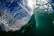 In fluid dynamics, wind waves or, more precisely, wind-generated waves are surface waves that occur on the free surface of oceans, seas, lakes, rivers, and canals or even on small puddles and ponds. They usually result from the wind blowing over a vast enough stretch of fluid surface. Waves in the oceans can travel thousands of miles before reaching land. Wind waves range in size from small ripples to huge waves over 30 meters high. When directly being generated and affected by the local winds, a wind wave system is called a wind sea. After the wind ceases to blow, wind waves are called swell. Or, more generally, a swell consists of wind generated waves that are not--or hardly--affected by the local wind at that time. They have been generated elsewhere, or some time ago. Wind waves in the ocean are called ocean surface waves.