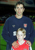 Robert Pires with Arsenal mascot James Aldrich. Chelsea 2:2 Arsenal, F.A. Carling Premiership, 6/9/2000. Credit: Colorsport / Stuart MacFarlane.