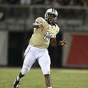 ORLANDO, FL - OCTOBER 09:  Justin Holman #13 of the UCF Knights passes the football at Bright House Networks Stadium on October 9, 2014 in Orlando, Florida. (Photo by Alex Menendez/Getty Images) *** Local Caption *** Justin Holman