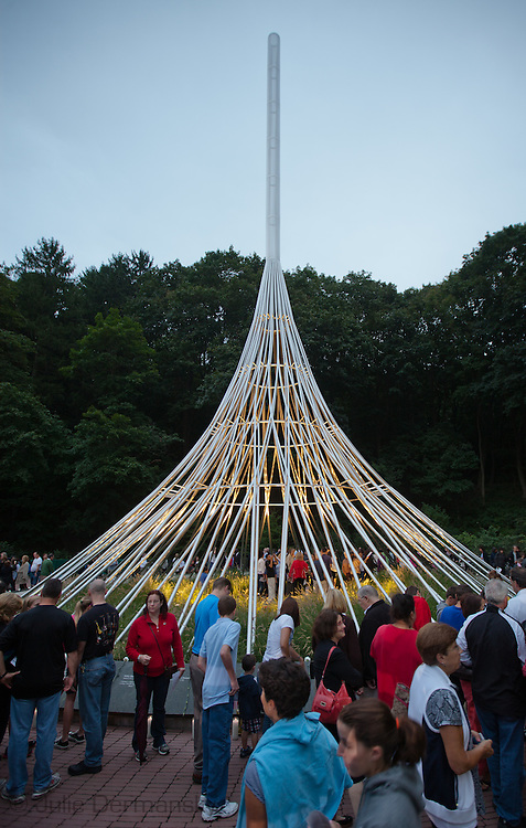 Candles lit and placed around the Rising, a memorial located in the Kensico Dam Plaza of Valhalla, Westchester County, New York, created by architect Frederic Schwartz commemorating the victims of 9/11 from Westchester County, during  a memorial held on the 10 Year Anniversary of 9/11