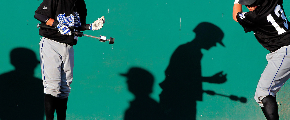 Late afternoon sunlight creates dramatic shadows at San Jose Municipal Stadium as Monte Vista Christian's Andy and Austin Muller get in their warmup swings prior to the Mustangs' Central Coast Section semi-finals. MVC lost the game to the Menlo School 8-2.<br /> Photo by Shmuel Thaler <br /> shmuel_thaler@yahoo.com www.shmuelthaler.com