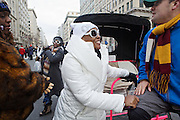 Valaur Dickerson, 37, brown from left, Stacy Peebles, 38, Kynedra Ogunnaike, 37, all from St. Louis, arrive to the line for the parade route in a run by Tom Ball on 14th Street during the inauguration ceremonies for Pres. Barack Obama on January 21, 2013 in Washington, D.C.