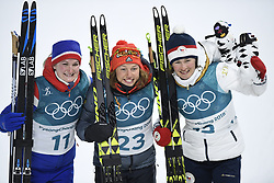 February 10, 2018 - Pyeongchang, South Korea - Gold medalist LAURA DAHLMEIER of Germany, center, is flanked by silver medalist  MARTE OLSBU,  of Norway, left, and bronze medalist VERONIKA VITKOVA,, as they celebrate following the Womens Biathlon 7.5km Sprint Saturday, February 10, 2018 at Alpensia Biathlon Centre at the Pyeongchang Winter Olympic Games.  Photo by Mark Reis, ZUMA Press/The Gazette (Credit Image: © Mark Reis via ZUMA Wire)