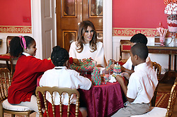 First Lady Melania Trump participates in arts and crafts projects with children and students from Joint Base Andrews in the East Wing of the White House in Washington, DC, November 27, 2017. Credit: Olivier Douliery / Pool via CNP. 27 Nov 2017 Pictured: First Lady Melania Trump participates in arts and crafts projects with children and students from Joint Base Andrews in the Red Room of the White House in Washington, DC, November 27, 2017. Credit: Olivier Douliery / Pool via CNP. Photo credit: Olivier Douliery - Pool via CNP / MEGA TheMegaAgency.com +1 888 505 6342