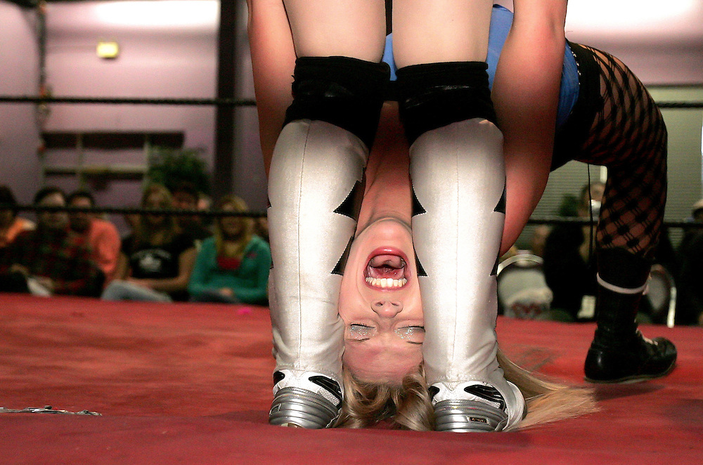 """(030506 -Somerville, MA)  Amanda Buckland, """"Synndy"""" 21, of Rochester, NY, gets her hair and head stepped on by """"Alexa Thatcher"""" during a World Women's Wrestling event at the Good Time Emporium."""