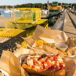 A lobster roll and corn on the dock behind Luke's Restaurant on Miller's Wharf in Tenants Harbor, Maine.