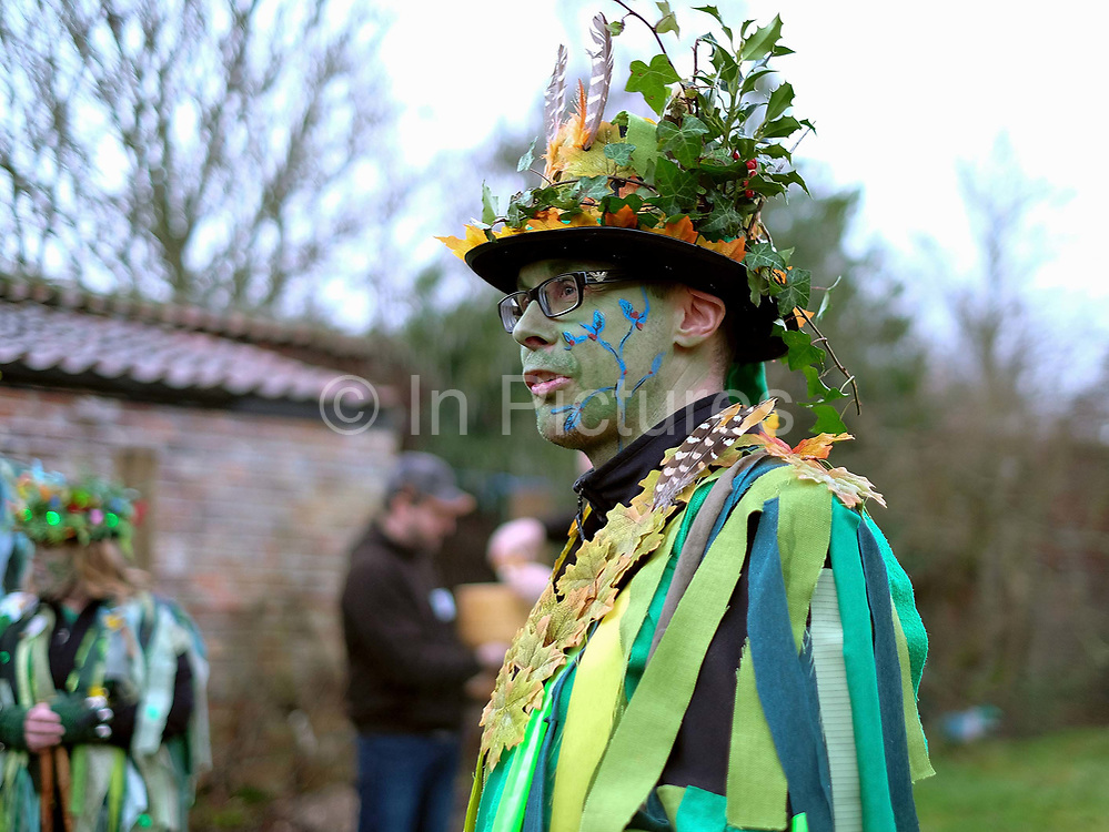 The Green Man at an orchard-visiting wassail in Kilham village, Yorkshire Wolds, UK on 21st January 2017. Wassail is a traditional Pagan winter celebration in cider-producing regions of England, reciting incantations and singing to the trees to promote a good harvest for the coming year. Pieces of toast soaked in cider are hung in the branches to attract robins to the tree as these are said to be the good spirits of the orchard. To ward off evil spirits, villagers scare them away by banging pots and pans and making as much noise as possible