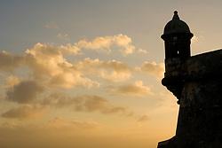 Caribbean, Puerto Rico, Old San Juan.  El Morro Fort (San Felipe del Morro Fortress), built 1540-1783.  Turret  and clouds at sunset.