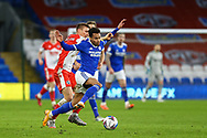 Cardiff City's Josh Murphy (11) is fouled by Millwall's Shaun Hutchinson (4) during the EFL Sky Bet Championship match between Cardiff City and Millwall at the Cardiff City Stadium, Cardiff, Wales on 30 January 2021.