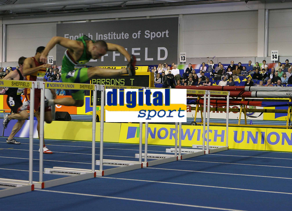 Photo: Rich Eaton.<br /> <br /> Norwich Union European Indoor Trials and UK Championships, Sheffield. 11/02/2007. Andy Turner of Sale clears the final hurdle to win the mens 60 metres hurdles