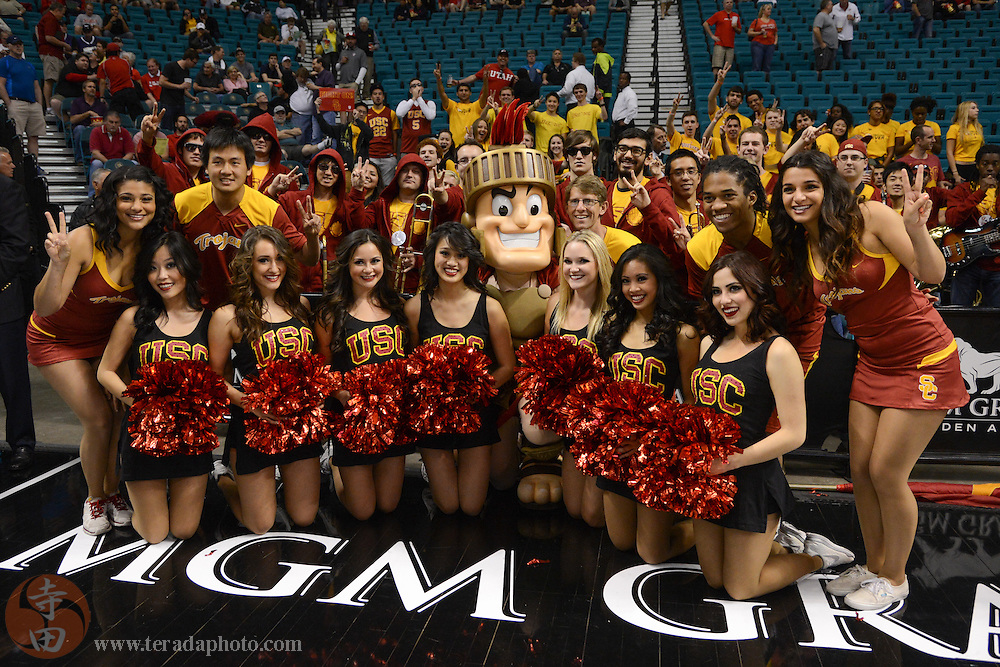 Mar 12, 2014; Las Vegas, NV, USA; Southern California Trojans mascot, cheerleaders, and dancers pose for photos before the game against the Colorado Buffaloes in the first round of the Pac-12 Conference Tournament at MGM Grand Garden Arena. The Buffaloes defeated the Trojans 59-56.