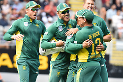 March 4, 2017 - Auckland, New Zealand - Jean-Paul Duminy of South Africa celebrates with his team mate Quinton de Kock the run out of Mitchell Santner.of New Zealand during the final match of  One Day International series between New Zealand and South Africa at Eden Park on March 4, 2017 in Auckland, New Zealand (Credit Image: © Shirley Kwok/Pacific Press via ZUMA Wire)