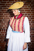 Rebekka, member of the 'Die Blankeneser Trachtengruppe 1984 – 2014 im Blankeneser Männer TurnVerein' is wearing an original traditional bridal costume in Blankenese, Hamburg, Germany on November 5, 2016.<br /> <br /> The bridal dress has been worn by young women from the low income class (Brauttracht der Unbemittelten).<br /> <br /> This is part of the series about Traditional Wedding Gowns from different regions of Germany, worn by young members of local dance groups and cultural associations that exist to preserve and celebrate the cultural heritage. The portraiture series is a depiction of an old era with different social values and religious beliefs in an antiquated civil society with very few of those dresses left.