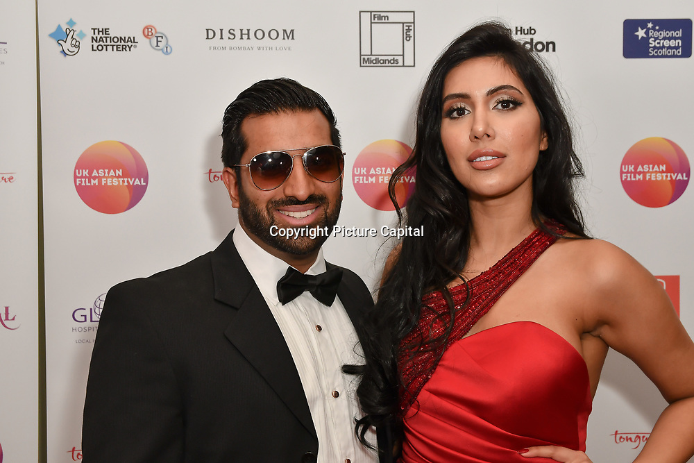 Yanick Ghanty and Nisha Aaliya attends the UK Asian Film Festival closing flame awards gala - Red Carpet at BAFTA 195 Piccadilly, on 7 April 2019, London, UK