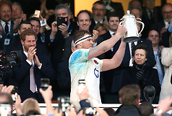 11 March 2017 : 6 Nations Rugby : England v Scotland :<br /> England captain Dylan Hartley holds up the Calcutta Cup watched by Prince Harry and Princess Anne.<br /> Photo: Mark Leech