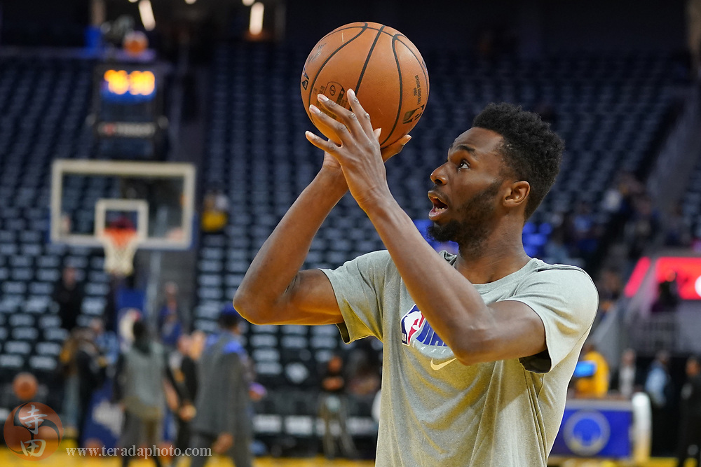 February 27, 2020; San Francisco, California, USA; Golden State Warriors guard Andrew Wiggins (22) warms up before the game against the Los Angeles Lakers at Chase Center.