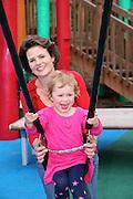 Mum & daughter playing in kids playground