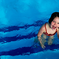 (PPAGE1) SEA BRIGHT 7/29/2003  4 year old Delores Sharaf of Rumson smiles happy with herself for learning how to swim in the pool of the Driftwood beach club in Sea Bright    Michael J. Treola Staff Photographer....MJT