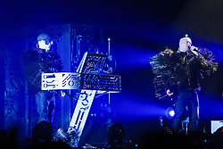 © Licensed to London News Pictures. 18/06/2013. London, UK.   Pet Shop Boys performing live at The O2 Arena - Chris Lowe (left) and Neil Tennant (right) and in this pic. Pet Shop Boys are an English electronic pop duo, consisting of Neil Tennant, who provides main vocals, keyboards and occasional guitar, and Chris Lowe on keyboards and occasional vocals.  Photo credit : Richard Isaac/LNP