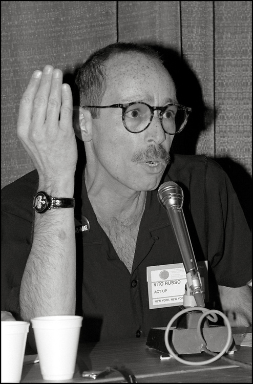 """Vito Russo of ACT UP speaking on a panel about the possible Antiviral drugs that could be used to combat HIV/AIDS at the Fifth International AIDS Conference.<br /> <br /> Vito Russo was an American LGBT activist, film historian and author. He wrote The Celluloid Closet, described in The New York Times as """"an essential reference book"""" on homosexuality in the US film industry, co-founded the Gay and Lesbian Alliance Against Defamation, a media watchdog organization that strives to end anti-LGBTQ rhetoric, and advocated for LGBTQ inclusion in popular media. Russo was diagnosed with HIV in 1985, and died of AIDS-related complications in 1990."""