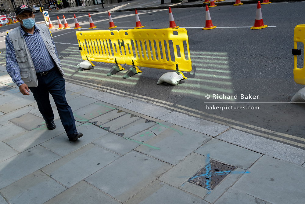At a time when workers are still largely working from hom during the Coronavirus pandemic, yellow pavement widening barriers line Threadneedle Street in the City of London, the capital's financial district, on 1st September 2020, in London, England.