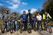 A happy group of male and female cyclists line up outside the entrance to the Devonshire Tunnel eagerly awaiting the official opening of the Two Tunnel Greenway in Bath, Somerset, England, United Kingdom on 6th April 2013.  The cyclists are going to be some of the first members of the public to enjoy the fantastic 13-mile circular route from the centre of Bath that takes in National Cycle Route 24 and National Route 4 and the spectacular Dundas Aqueduct on the Kennet & Avon Canal.  The opening of this route has been organised by Sustrans in partnership with Bath and North East Somerset Council.  It has been funded by the Lottery. Sustrans is a charity that works with communities, policy-makers and partner organisations so that people can choose healthier, cleaner and cheaper journeys and enjoy better, safer spaces to live in. The event was attended by hundreds of cyclists and pedestrians of all ages and abilities.