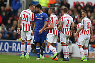 Diego Costa of Chelsea squares up to Geoff Cameron of Stoke city (l).  Premier league match, Stoke City v Chelsea at the Bet365 Stadium in Stoke on Trent, Staffs on Saturday 18th March 2017.<br /> pic by Andrew Orchard, Andrew Orchard sports photography.