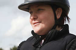 Portrait of woman with visual impairment having riding lesson.